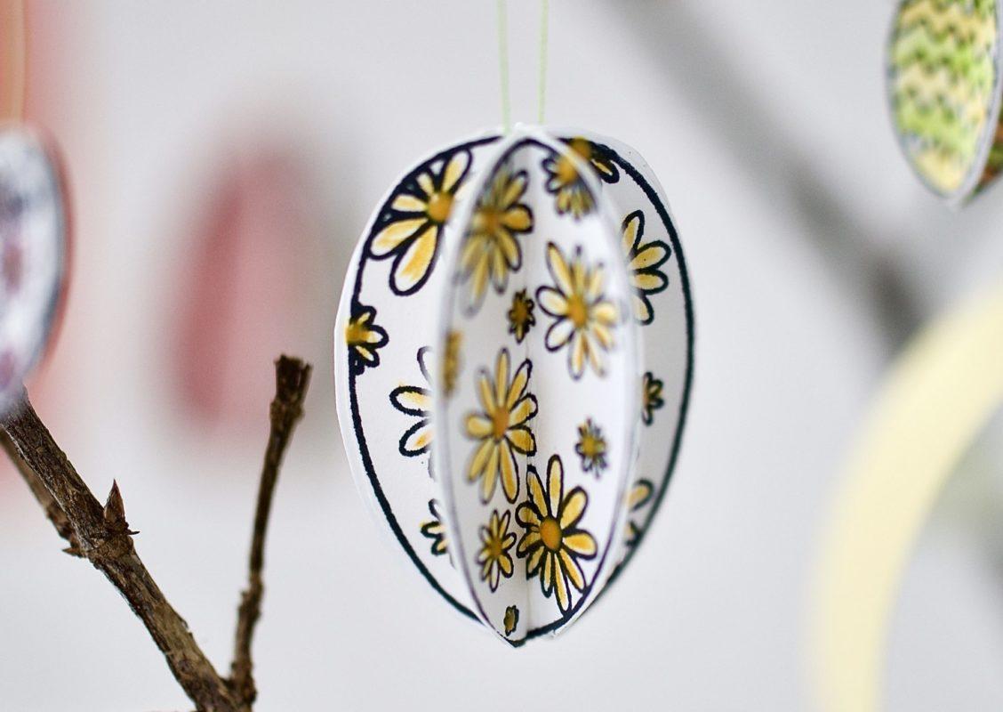 Ei mehrmals aufstempeln, bemalen, in die Hälfte Falten und ca 5 Eier beim Falz zusammenkleben, sodass sie dreidimensional wirken..